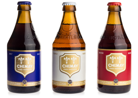 tripple: Bottles of Chimay Blue, White and Red beer isolated on a white background Editorial