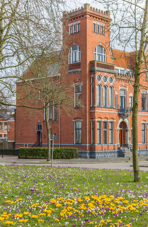 Red brick building and crocusses in Groningen, The Netherlands