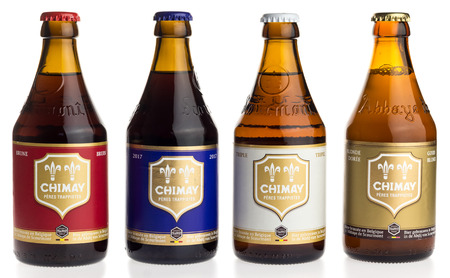 tripple: Bottles of Chimay Blue, White, Blonde and Red beer isolated on a white background