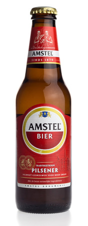 pilsener: Bottle of Dutch Amstel Pilsener beer isolated on a white background