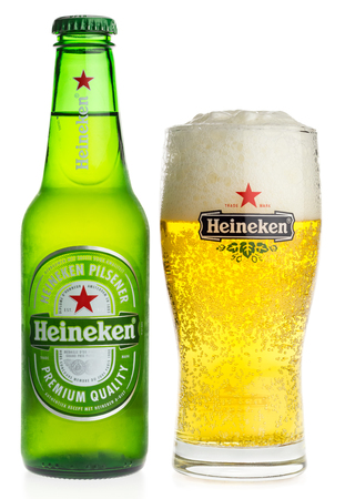 pilsener: Bottle and glass of Heineken Pilsener beer isolated on a white background Editorial