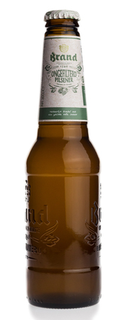 pilsener: Bottle of Dutch Brand Ongefilterd Pilsener beer isolated on a white background Editorial