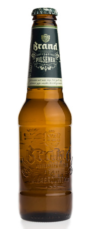 pilsener: Bottle of Dutch Brand Pilsener beer isolated on a white background Editorial