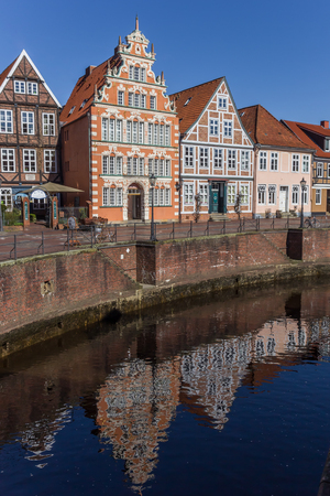 Old houses with reflection in the water in Stade, Germany Editorial