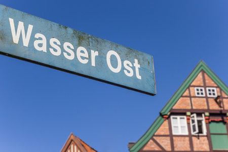 Street sign at hte historical harbor of Stade, Germany