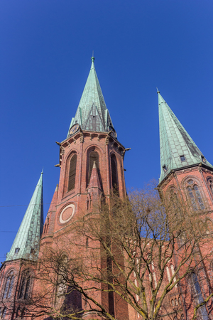 st german: Towers of the Lamberti church in Oldenburg, Germany Stock Photo