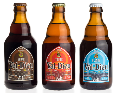 brune: Bottle of Belgian Val Dieu Brune, Triple and Blonde beer isolated on a white background