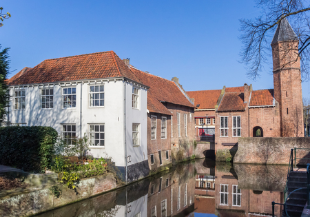 holland: City gate and houses at a canal in Amersfoort, Holland Editorial