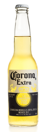 Bottle of Mexican Corona Extra beer isolated on a white background Redakční