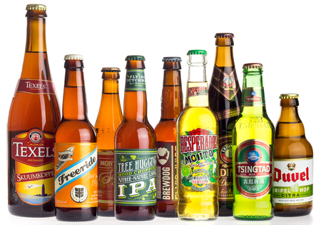 Collection of Texels, Freeride, Monteiths, Flying Dutchman, Brewdog, Desperados, Erdinger, Tsingtao and Duvel beers from all over the world isolated on a white background