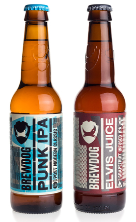 Bottles of Scottish Brewdog Punk IPA and Elvis Juice beer isolated on a white background
