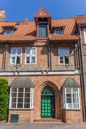 Historic house with green door in Luneburg, Germany