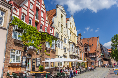 Tourists having a drink at a cafe in the historic harbor of Luneburg