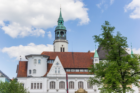 Town hall and church tower in the center of Celle, Germany Stock Photo