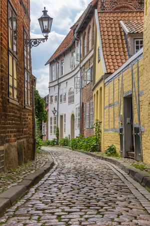 Cobblestoned street with colorful houses in Luneburg, Germany