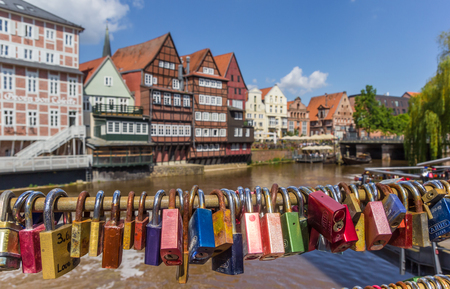 half timbered house: Love locks attached to the bridge in the old harbor of Luneburg, Germany Editorial
