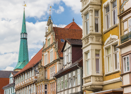 Colorful facades and church tower in the center of Hameln, Germany Stock Photo