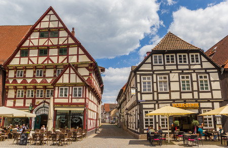 People enjoying the sun at restaurants on the central square of Hameln, Germany Editorial