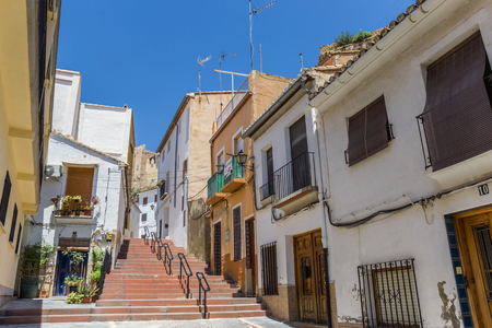 he: Colorful street and steps leading to he castle of Bunol, Spain