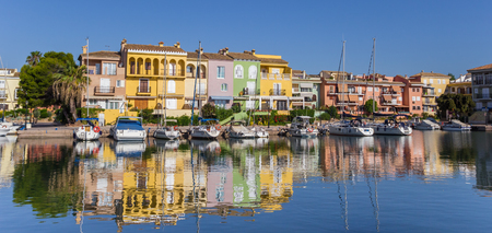 valencia orange: Panorama of boats and colorful houses of Port Saplaya in Valencia, Spain