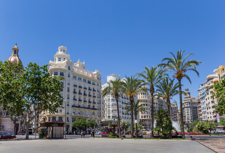 governement: Governement buildings and palm trees at the Plaza Ayuntamiento in Valencia