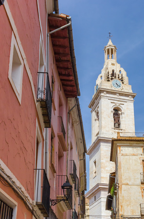 Church tower and red house in the center of Xativa, Spain Stock Photo