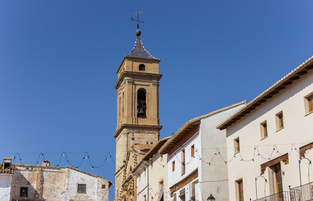 Church tower and white houses at the central square of Requena, Spain