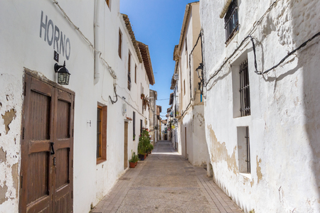 Narrow street with white houses in Requena, Spain Editorial