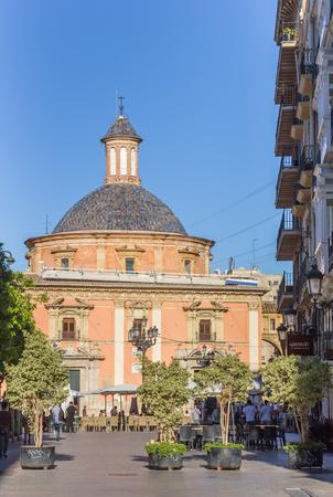 refelction: Street leading to the Basilica de la Virgen in Valencia, Spain