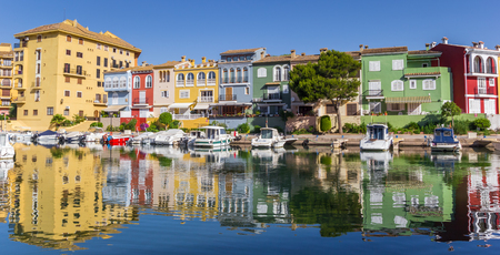 refelction: Panorama of boats and colorful houses of Port Saplaya in Valencia, Spain