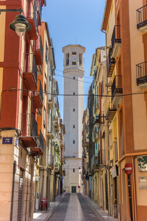 colorfull: Colorful street and tower of the Sant Maure and Francesc church in Alcoy, Spain Editorial