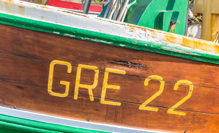 Identification number on an old fishing boat in Greetsiel, Germany