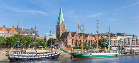 Panorama of historical ships and church in Bremen, Germany