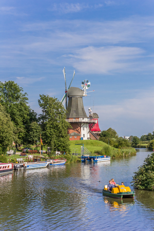 peddle: Tourists in a paddle boat on the river in Greetsiel, Germany