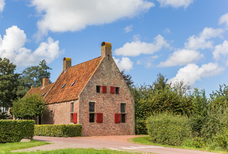 Historic red brick house in the village of Wetsinge, Netherlands Фото со стока - 87398347