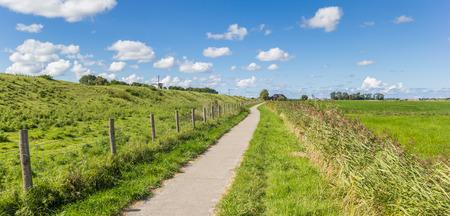 Panorama of a bicycle path along a dike near Garnwerd, Netherlands
