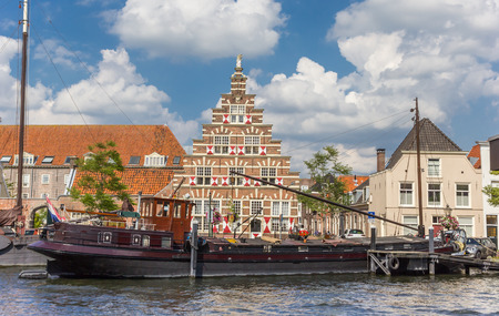 Old ship and historic facade in the center of Leiden, Netherlands Stock Photo