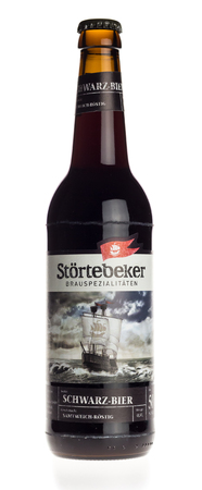 Bottle of Stortebeker Schwarz beer isolated on a white background Editorial