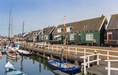 Sailing boats in the old harbor of Marken, Holland