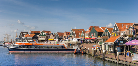 Tour boat in the historic harbor of Volendam, Netherlands