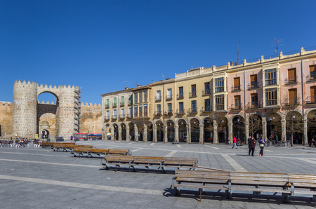 Benches and houses on the Teresa Square of Avila, Spain Editorial