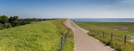 Panorama of a dike road on the Wadden island of Texel, The Netherlands Stock Photo - 104723358