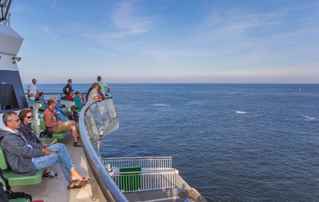 People enjoying the boat trip from Texel island to Den Helder city in Holland