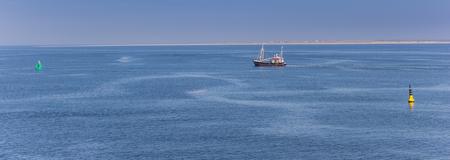 Little fishing boat in the Wadden sea, he Netherlands