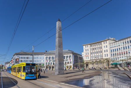 Tram and obelisk at the Konigsplatz square of Kassel, Germany