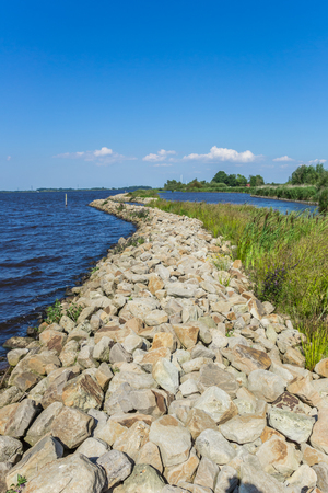 Small dike at the Schildmeer lake in Groningen, The Netherlands