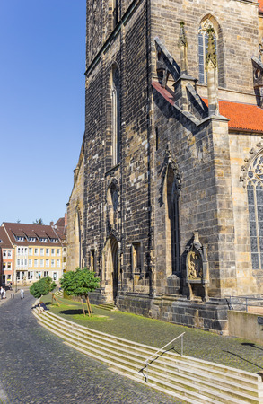 Cobblestoned street at the St. Andreas church of Hildesheim, Germany