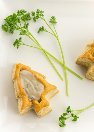 Puff pastry vol-au-vents shaped like a christmas tree and filled with mushroom ragout Фото со стока