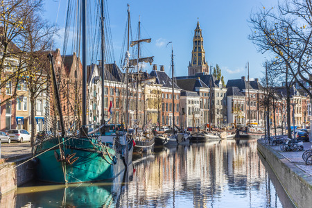 Historic ships in the Hoge der aa canal of Groningen, The Netherlands 写真素材