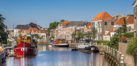 Panorama of a canal with old ships and historical houses in Zwolle, The Netherlands